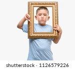 dark haired little child... | Shutterstock . vector #1126579226