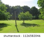 Stock photo wooden post and cloth line on farmhouse lawn in southern denmark 1126582046