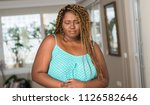 african american woman at home... | Shutterstock . vector #1126582646