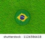 brazil flag on football on... | Shutterstock . vector #1126586618