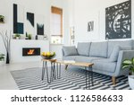 real photo of a grey sofa... | Shutterstock . vector #1126586633