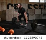 fit young man lifting barbells  ... | Shutterstock . vector #1126590743