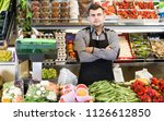 male seller showing assortment... | Shutterstock . vector #1126612850
