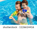 handsome father and adorable... | Shutterstock . vector #1126614416