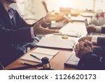 business lawyer team. working... | Shutterstock . vector #1126620173