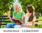 grandmother and granddaughter... | Shutterstock . vector #1126623344
