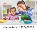 happy mother and daughter are... | Shutterstock . vector #1126623350