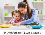 happy mother and daughter are... | Shutterstock . vector #1126623368