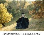 princess in a vintage dress.... | Shutterstock . vector #1126664759