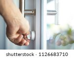 glass door lock  door unlocking ... | Shutterstock . vector #1126683710