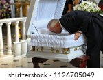editorial use only. burial... | Shutterstock . vector #1126705049