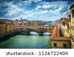 famous bridge ponte vecchio on... | Shutterstock . vector #1126722404
