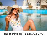 summer time.  girl in a hat... | Shutterstock . vector #1126726370
