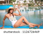 summer time.  girl in a hat... | Shutterstock . vector #1126726469