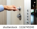 security door   hand close and... | Shutterstock . vector #1126745240