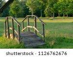 short bridge in park | Shutterstock . vector #1126762676