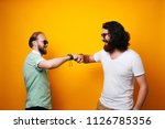 two friends or brothers giving...   Shutterstock . vector #1126785356