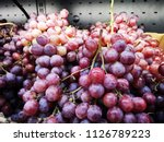red  grapes in the market | Shutterstock . vector #1126789223