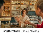 young male bartender holding a... | Shutterstock . vector #1126789319