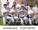 group of children sunday  june... | Shutterstock . vector #1126796096