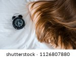 young woman sleep with alarm... | Shutterstock . vector #1126807880