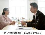 serious male boss reading... | Shutterstock . vector #1126819688