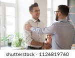 male employer shaking hand of... | Shutterstock . vector #1126819760