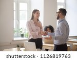 male boss congratulating female ... | Shutterstock . vector #1126819763