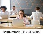 smiling young employee working... | Shutterstock . vector #1126819886