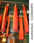 pastrami hanging at market | Shutterstock . vector #1126820393