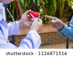 the doctor is measuring... | Shutterstock . vector #1126871516