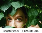 girl with green eyes surrounded ...   Shutterstock . vector #1126881206