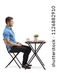young man sitting at a coffee... | Shutterstock . vector #1126882910