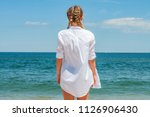 beautiful tanned woman in white ... | Shutterstock . vector #1126906430