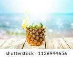 fresh pineapple and summer time  | Shutterstock . vector #1126944656