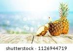 fresh pineapple and summer time  | Shutterstock . vector #1126944719