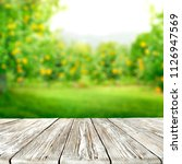 table space of wood and summer... | Shutterstock . vector #1126947569