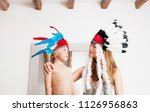 brother and sister playing... | Shutterstock . vector #1126956863
