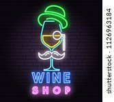 retro neon wine sign on brick... | Shutterstock .eps vector #1126963184