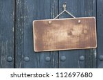 wooden signboard with rope... | Shutterstock . vector #112697680
