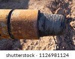 oil drill pipe. rusty drill... | Shutterstock . vector #1126981124
