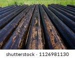 oil drill pipe. rusty drill... | Shutterstock . vector #1126981130