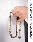 saudi arabian man holding... | Shutterstock . vector #1126985123
