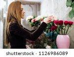 florist woman on the work on... | Shutterstock . vector #1126986089