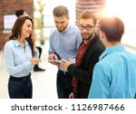 business team with tablet pc... | Shutterstock . vector #1126987466