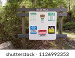 Small photo of Mark Twain National Forest, AR / USA, April 29, 2018: Information sign at Boze Mill Float Camp. Path leads to natural spring & old mill ruins. Now used for camping, fishing & floating on the river