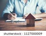businessman hand models of a... | Shutterstock . vector #1127000009