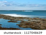 breakwater in a small fishing... | Shutterstock . vector #1127048639