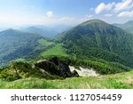 the slope with view on cross... | Shutterstock . vector #1127054459