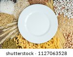 white plate and foods high in... | Shutterstock . vector #1127063528